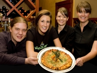 Enjoy a pizza at Capers